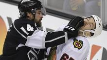 Los Angeles Kings right wing Justin Williams fights with Chicago Blackhawks center Andrew Shaw (Jae C. Hong/Associated Press)