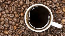 Coffee mug and beans. (iStockphoto)