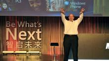 Microsoft CEO Steve Ballmer introduces the upcoming Windows Phone, which will arrive in China over the next few months, in Beijing on May 24, 2011. (STR/AFP/Getty Images)