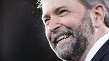 New NDP leader Thomas Mulcair smile on stage during the NDP leadership convention in Toronto on Saturday, (Chris Young/The Canadian Press/Chris Young/The Canadian Press)