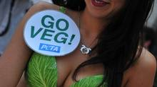 """The PETA """"Lettuce Ladies"""" arrive to serve Vegan hot dogs on July 13, 2011 during a demonstration event on Capitol Hill in Washington. PETA is calling attention to alternatives to meat products. (KAREN BLEIER/KAREN BLEIER/AFP/Getty Images)"""