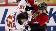 Ottawa Senators Matt Kassian (right) fights with Calgary Flames Kevin Westgarth during second period NHL action Sunday March 30, 2014 in Ottawa. (Adrian Wyld/THE CANADIAN PRESS)