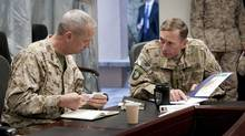 General John R. Allen, left,  incoming commander, International Security Assistance Force (ISAF)/U.S. Forces- Afghanistan (USFOR-A) and General David H. Petraeus, commander, ISAF/USFOR-A, attend a meeting in Kabul, Afghanistan in this July 9, 2011 file photograph. (Joshue Treadwell/REUTERS/U.S. Navy/Handout)