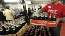 Although not cheap, Coca-Cola's growth prospects in India, China and Russia make forward price-to-earnings multiples appear reasonable. (Andrew Link/The Associated Press)