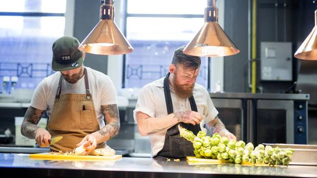 Chefs and co-owners at Ayden restaurant in Saskatoon Dale MacKay and Nathan Guggenheimer (left to right) cut and prepare vegetables. David Stobbe for the Globe and Mail