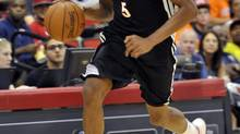 Toronto's Bruno Caboclo brings the ball up court during an NBA summer league basketball game against Denver on Saturday, July 12, 2014, in Las Vegas. (DAVID BECKER/AP)