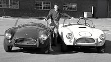Carroll Shelby poses with his 1964 production Cobra and his Cobra race car. (Ford Ford)
