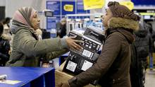 Customers shop at a Best Buy store in Toronto on December 26, 2010, as thousands of Canadians are scouring malls and stores today hoping to score deep discounts in the traditional Boxing Day sales. (THE CANADIAN PRESS/Chris Young)