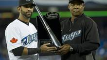 Toronto Blue Jays Jose Bautista (left) is presented with the Silver Slugger award by hitting coach Dwayne Murphy (Nathan Denette/The Canadian Press)