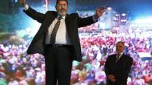 Mohammed Morsi hold a rally in Cairo on May 20, 2012. (FREDRIK PERSSON/ASSOCIATED PRESS)