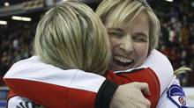 Team Canada skip Jennifer Jones, right, hugs third Cathy Overton-Clapham, left, after defeating Team Prince Edward Island 8-7 during final game action at the 2010 Scotties Tournament of Hearts in Sault Ste. Marie, Ont., on Sunday, Feb. 7, 2010. The pair will face each other as opponents at the Scotties Tournament of Hearts on February 23. THE CANADIAN PRESS/Nathan Denette (Nathan Denette)