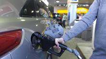 A motorist fills up as a gas station in Toronto in this file photo. (Fred Lum/Fred Lum/The Globe and Mail)