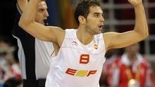 Spain's guard Jose Manuel Calderon reacts after hitting a three-point shot against Croatia during the first quarter of their men's quarterfinal basketball game at the Beijing 2008 Olympics in Beijing, Wednesday, Aug. 20, 2008. (Eric Gay/AP)