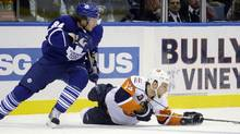 New York Islanders' Rob Schremp, right, slips on the ice while battling for the puck against Toronto Maple Leafs' Mikhail Grabovski in the first period of an NHL hockey game Wednesday, Dec. 23, 2009, in Uniondale, N.Y. (AP Photo/Julie Jacobson) (Julie Jacobson)