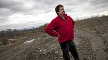 Gord Hamilton walks on landfill he ordered from Green For Life on his country property near Pickering Nov. 10, 2011. Hamilton has since found that the fill he received shows signs of contaminated. (Moe Doiron/The Globe and Mail/Moe Doiron/The Globe and Mail)