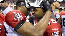 Calgary Stampeders QB Kevin Glenn (R) is congratulated by a team mate on their win over the B.C. Lions in the Wester Conference Final in Vancouver November 18, 2012. (John Lehmann/The Globe and Mail)