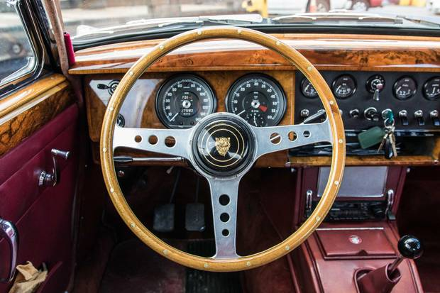 With a whiff of leather and a dash of wooden burl trim, the Mk II's interior is refined and elegant.