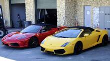 A Ferrari (left) and a Lamborghini sit in a police impound lot in Miami Beach, Florida January 23, 2014. Pop singer Justin Bieber was arrested early Thursday on a drunk driving charge after he was caught drag racing on a main thoroughfare in a rented yellow Lamborghini, according to police. (GARY I ROTHSTEIN/REUTERS)