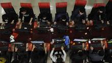 People use the computer at an Internet cafe in Taiyuan, Shanxi province March 31, 2010. The number of Internet users in China have crossed the half billion mark, reaching 505 million users at the end of November 2011, the China Internet Network Information Center (CNNIC) reported. (STRINGER SHANGHAI/REUTERS)