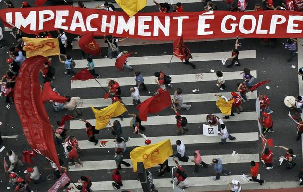 Members of labour unions protest in Sao Paulo on Dec. 16, 2015.