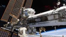 The newly installed Alpha Magnetic Spectrometer-2 is visible at center left in this photo of the International Space Station's starboard truss. (NASA)