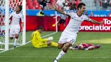 New England Revolution Benny Feilhaber celebrates a goal by teammate Chris Tierney (not seen) to tie the match in the 90th minute against Toronto FC during the second half of their MLS soccer match in Toronto, June 23, 2012. (MARK BLINCH/REUTERS)
