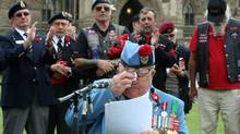 Ron Clarke wipes away tears as he addresses fellow veterans during a rally on Parliament Hill in Ottawa, Wednesday June 4, 2014. (FRED CHARTRAND/THE CANADIAN PRESS)