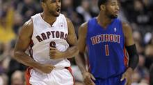 Toronto Raptors forward Alan Anderson celebrates a three-point basket in front of Detroit Pistons forward Andre Drummond (R) during the second half of their NBA game in Toronto December 19, 2012. (MIKE CASSESE/REUTERS)