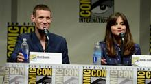 "Matt Smith, left, and Jenna Coleman participate in the ""Doctor Who"" 50th Anniversary panel on Day 5 of Comic-Con International on Sunday, July 21, 2013, in San Diego. (Jordan Strauss/AP)"