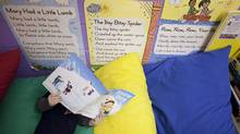 A child reads at a Calgary daycare centre operated by Edleun Group Inc., which plans to acquire seven Montessori daycares in Ontario. (Chris Bolin for The Globe and Mail)