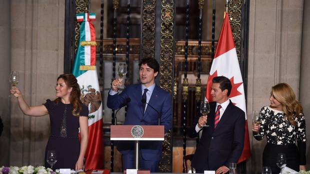 The Canadian and Mexican leaders and their wives make a toast at the National Palace.