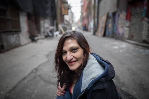 Melody Cooper, 41, poses for a photograph in the Downtown Eastside in Vancouver. Ms. Cooper, who has been using drugs since she was 27, is now receiving hydromorphone and says it has changed her life.