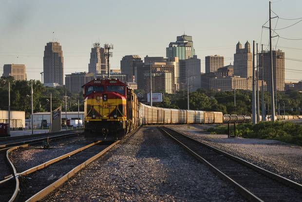 A Kansas City Southern locomotive sits in a rail yard in Kansas City, Mo.