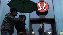 Pedestrians walk past a Lululemon Athletica store in New York, March 19, 2013. (LUCAS JACKSON/REUTERS)