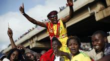 Supporters of Kenyan presidential candidate Uhuru Kenyatta celebrate his election win for him in Nairobi, Kenya Saturday, March 9, 2013. (Jerome Delay/AP)