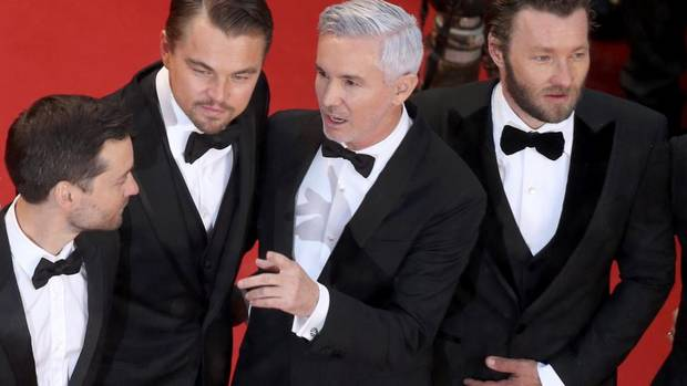 The Great Gatsby, the American classic remade by Baz Lurhmann which, after hitting North American theatres last week, opened the Cannes Film Festival on Wednesday. Directed by Baz Luhrmann (second from the right), it includes cast members Tobey Maguire (left), Leonardo DiCaprio (second-left) and Joel Edgerton (right). (Pool/Reuters)