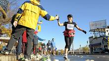 Water is fine for runs of less than an hour. But if you're out longer, hydrate with a sports drink. (Tibor Kolley/The Globe and Mail)