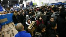 Thanks to online shopping, Canadians can now avoid the in-store Boxing Day melee and instead hunt bargains from their living rooms. (Fernando Morales/The Globe and Mail)