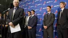 NHLPA Executive Director Donald Fehr (left) addresses journalists as he stands in front of players, including Sidney Crosby (centre) following collective bargaining talks in Toronto on Thursday October 18, 2012. (Chris Young/THE CANADIAN PRESS)