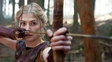 "Andromeda (played by Rosemund Pike) strains her bowstring in a scene from ""Wrath of the Titans."" (Jay Maidment/AP)"