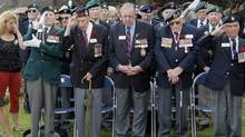 From left to right, Dieppe veterans Fred Engelbretch, 92, Arthur Rossel, 92, Roy Wozniak, 93, Russ Burrows, 93, and David Lloyd Hart, 95, during the commemorations of the failed Second World War invasion, in Dieppe, northern France, Sunday Aug. 19, 2012. (Michel Spingler/AP)