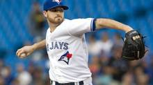 Toronto Blue Jays starting pitcher Drew Hutchison throws against the Baltimore Orioles during first inning AL baseball game action in Toronto Wednesday August 6, 2014. (Fred Thornhill/THE CANADIAN PRESS)