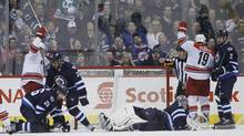 Carolina Hurricanes' Andrei Loktionov (8) and Jiri Tlusty (19) celebrate Eric Staal's (12) goal against Winnipeg Jets goaltender Al Montoya (35), Blake Wheeler (26), Dustin Byfuglien (33) and Adam Pardy (2)during second period NHL action in Winnipeg on Saturday, March 22, 2014. (JOHN WOODS/THE CANADIAN PRESS)