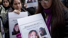 Molly Dixon, right, mother of Angeline Pete, holds up a picture of her missing daughter during a news conference outside the Missing Women Inquiry in Vancouver, B.C. Monday, Oct. 24, 2011. (JONATHAN HAYWARD/THE CANADIAN PRESS)