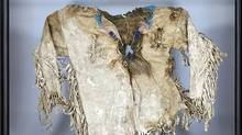 Lot 22 - Northern Plains Indian Child's Tunic, early 19th century fringed and with beaded collar, showing signs of central bullet trauma. (Waddingtons)