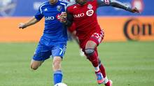 Montreal Impact midfielder Felipe Martins (7) battles Toronto FC defender Jeremy Hall (25) during first half Major League Soccer action Wednesday, June 27, 2012 in Montreal. (Ryan Remiorz/THE CANADIAN PRESS)