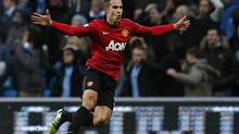 Manchester United's Robin Van Persie celebrates his goal against Manchester City during their English Premier League soccer match at The Etihad Stadium in Manchester, northern England December 9, 2012. (EDDIE KEOGH/REUTERS)