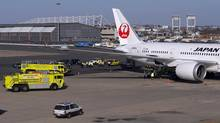 Emergency vehicles tend to a Japan Airlines Boeing 787 Dreamliner that caught fire at Logan International Airport in Boston on Monday, Jan. 7, 2013. (BRIAN SNYDER/REUTERS)