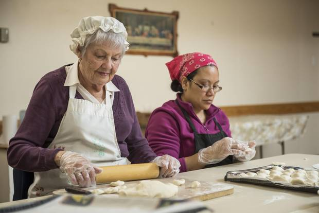 Anna Amborsky and Adda Morales prepare perogies in the basement of St. Gerard Parish.