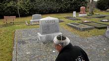 A man walks past the Leiser families gravestone following a public vigil at The Jewish Cemetery in Victoria. During the holidays several swastikas were spray painted on some of the Jewish gravestones including the Leiser Family's stone. (Chad Hipolito/The Globe and Mail/Chad Hipolito/The Globe and Mail)